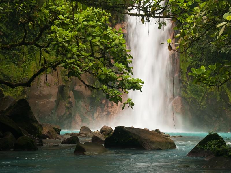Take a dip under a beautiful waterfall.